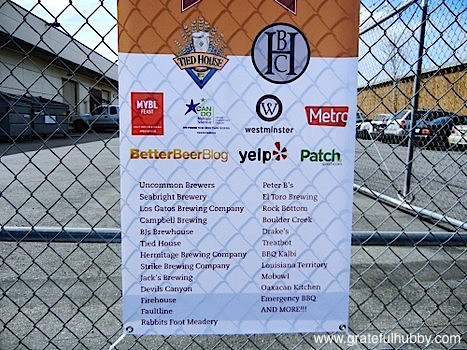 Banner of participating sponsors, brewing companies, and food trucks