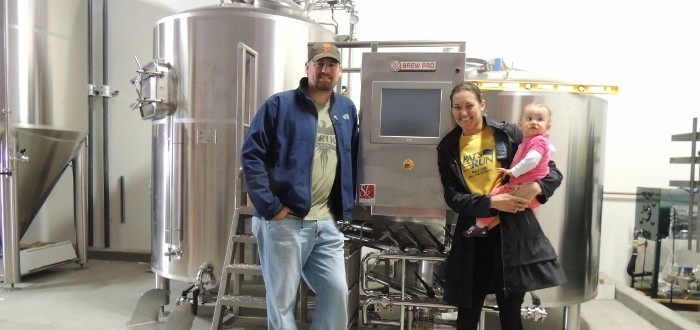 Drew Ehrlich and Jenny Lewis in front of their new brewhouse