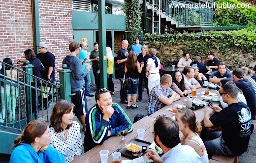 Folks enjoying the patio at Original Gravity Public House