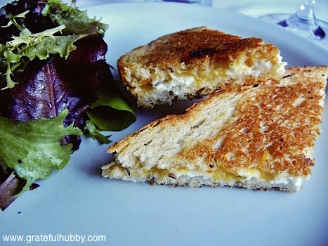 Goat cheese grilled cheese sandwich with apricot jam on rye bread