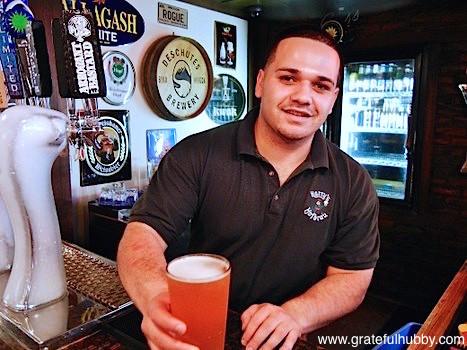 Jeremy Eseroma of Harry's Hofbrau San Jose serves a pint