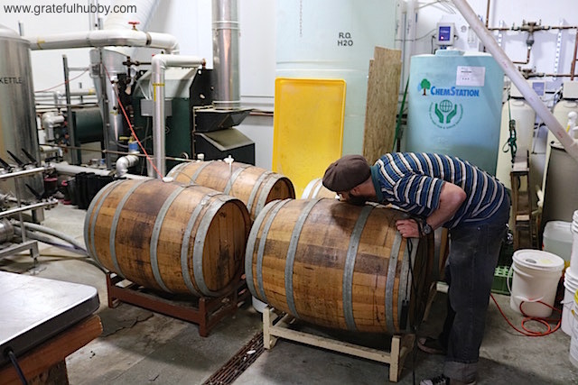 Strike brewer Tyler Rusten with 1 of the 4 recently filled barrels